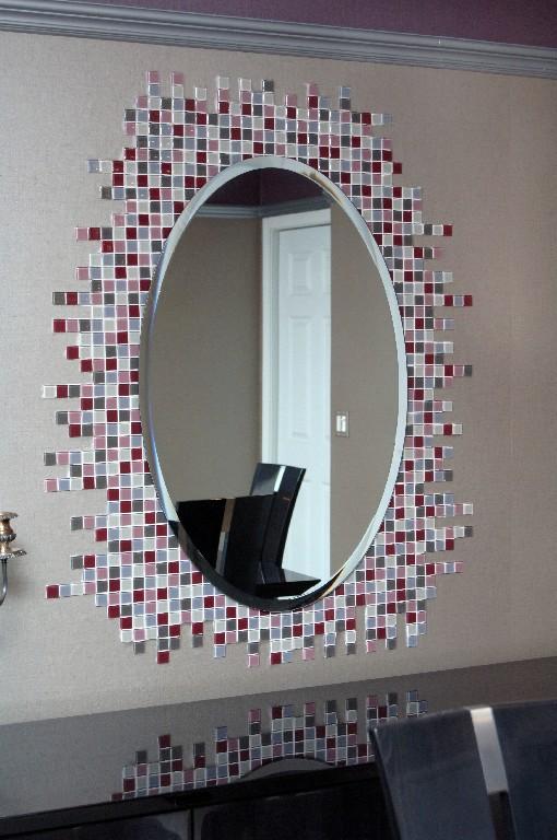 Custom glass tile design around mirror
