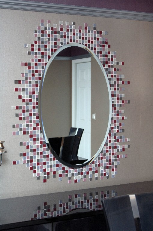 Custom glass tile design around mirror